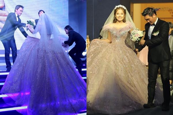 [Caption]Khánh Hiền diện váy cưới màu nude tùng xòe rộng cổ điển của nhà thiết kế Phạm Đặng Anh Thư sánh đôi chồng trong tiệc cưới ở TP HCM.